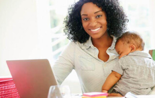 Woman with baby working