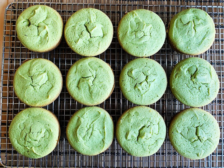 green tea mochi muffins on wire rack