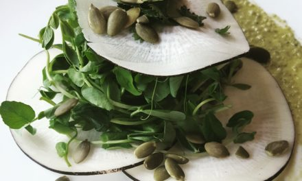 Black radish arugula salad with pumpkin seed dressing