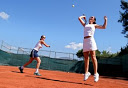 Family cultural immersion abroad - playing tennis