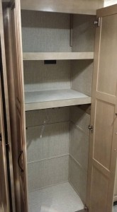 After Linen Closet w 2 shelves taken out and one clothes rod added