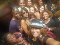 smiling attendees wall to wall in hotel elevator