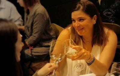 ladies toasting wine glasses
