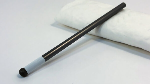 A fabric tipped stylus with its end raised on a fabric cushion.
