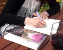 Julie signing book