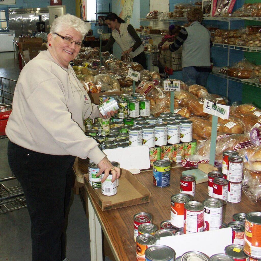 Volunteer sorting food