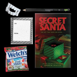 Secret Santa box with book, bookplate, black pencil, fruit snacks, and vampire teeth