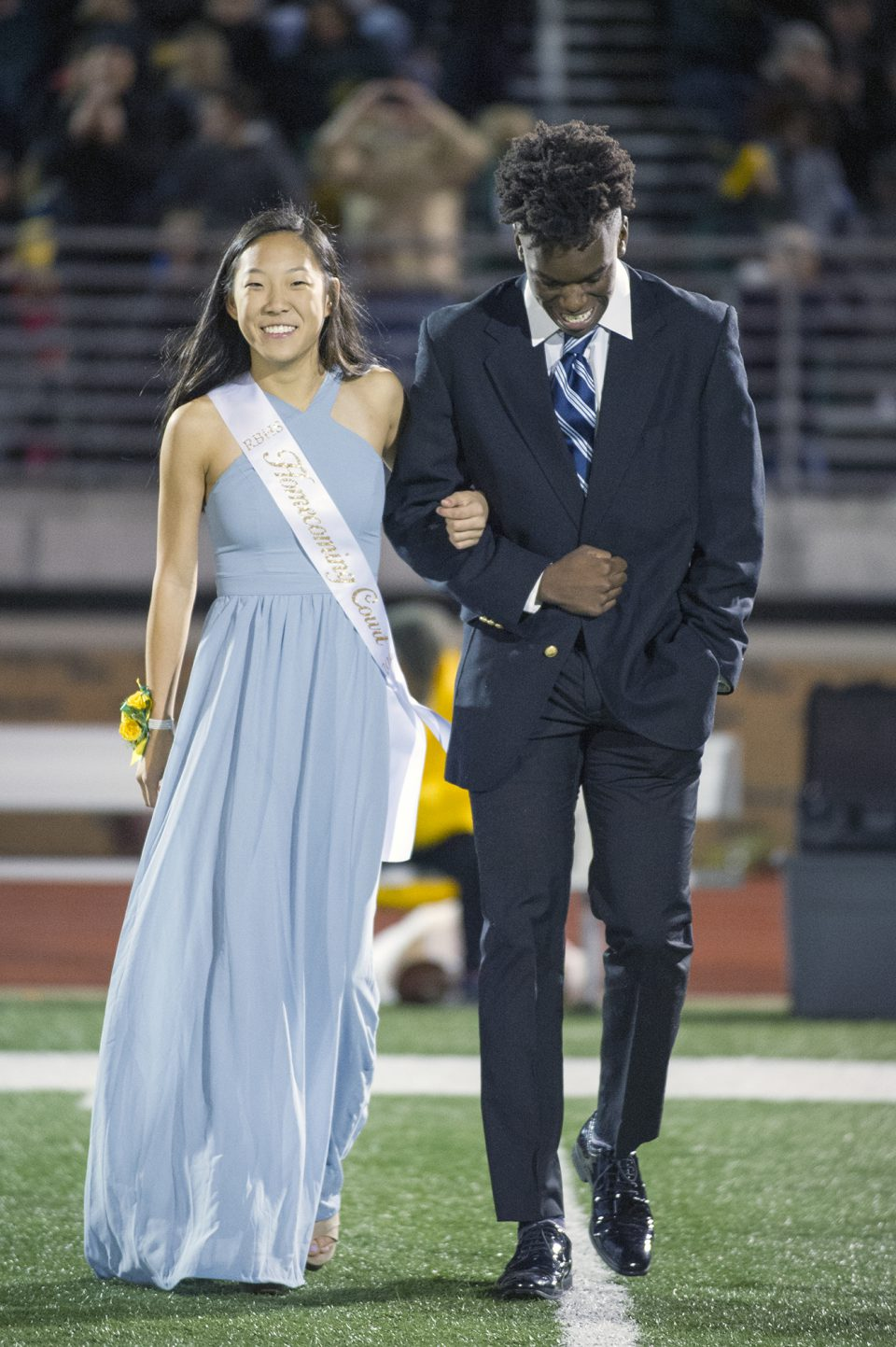 Homecoming queen candidate Ji-Sung Lee and escort  Mojuba Shonekan. Photo by Maya Bell.