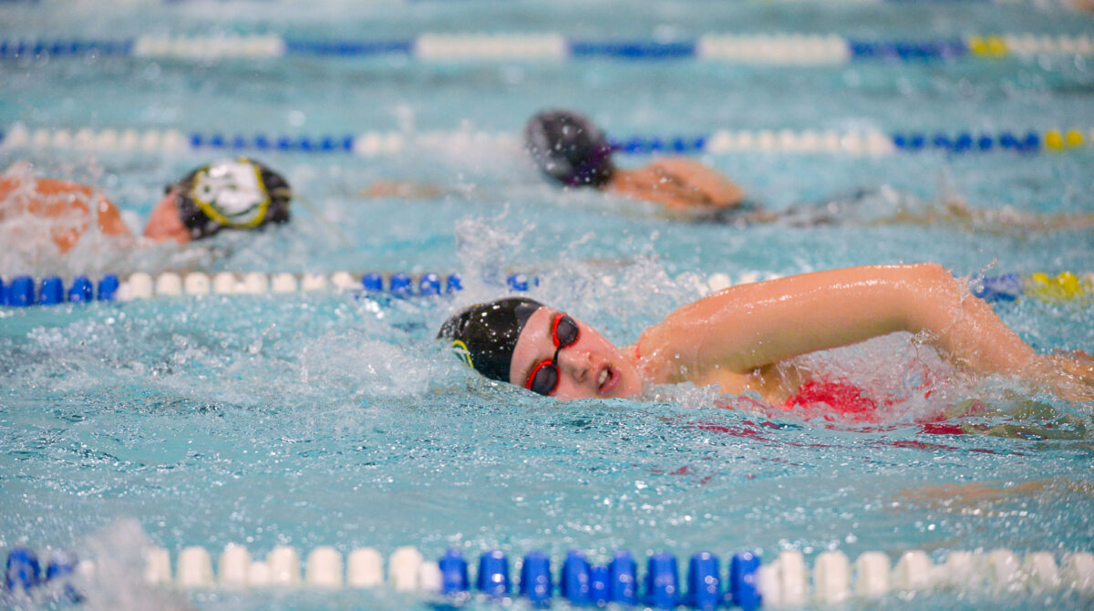 Sophomore Piper Forthaus swims freestyle at a 6 a.m. swim practice Friday, Dec. 7. Forthaus will compete at state this weekend.
