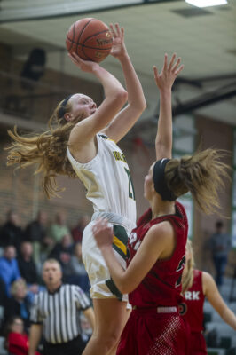 Sophomore Averi Kroenke goes up for a short jump shot during the fourth quarter of the game. Photo by Camryn DeVore.