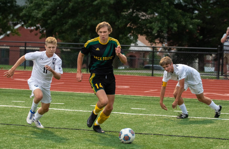 Senior forward Wesley Goyette gets past two Helias defenders at the boys' soccer senior night game Wednesday, September 9. Goyette scored two goals for the team during the match. Photo by Ana Manzano.