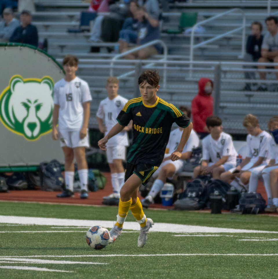 """Sophomore midfielder Cooper Allen dribbles the ball at the boys' soccer senior night game Wednesday, September 9. """" I wouldn't say we have set goals for this season,"""" Allen said. """"Really we just want to take this season game by game and be the best team we can be"""" Photo by Ana Manzano."""