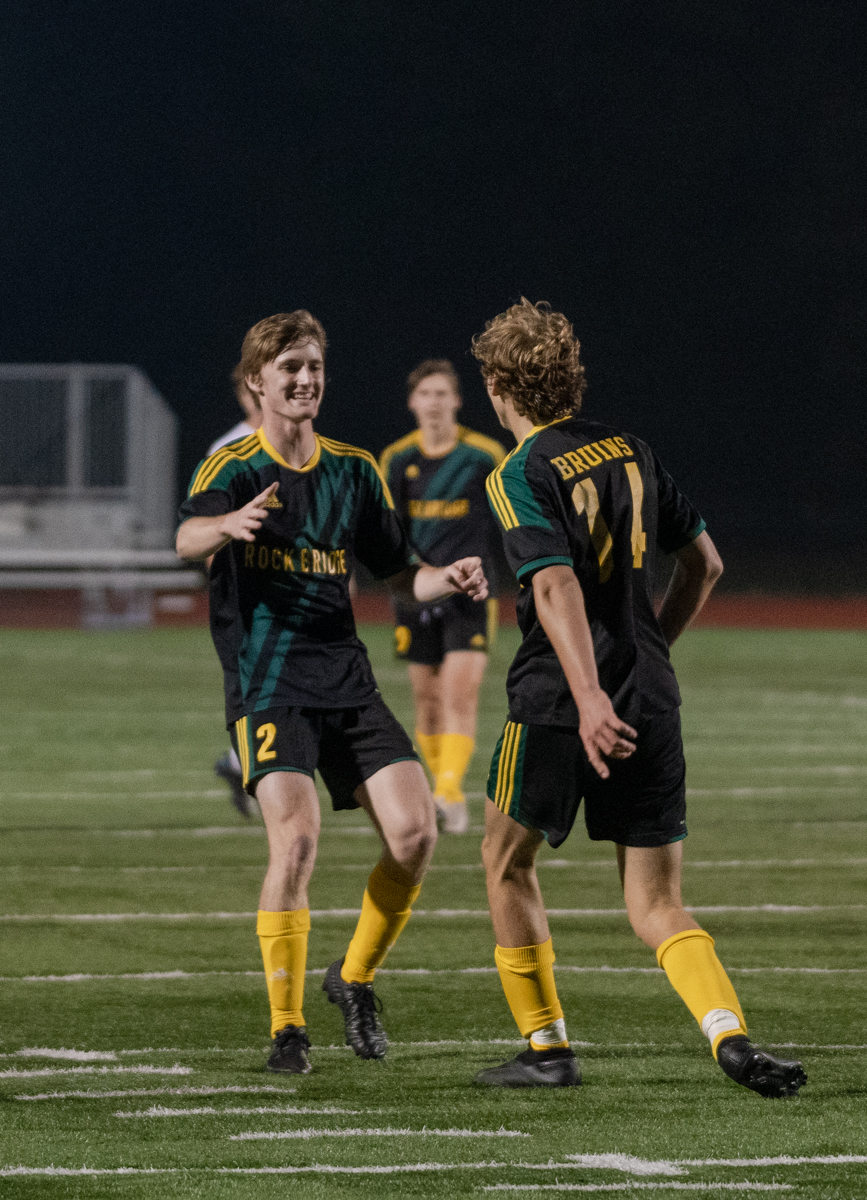 """Seniors Aaron Vandyke and Wesley Goyette celebrate scoring a goal at the boys' soccer senior night game Wednesday, September 9. """"We have a small roster with several sophomores,"""" Vandyke said. """"So that puts us at a disadvantage in size, subs, and experience."""" Photo by Ana Manzano."""