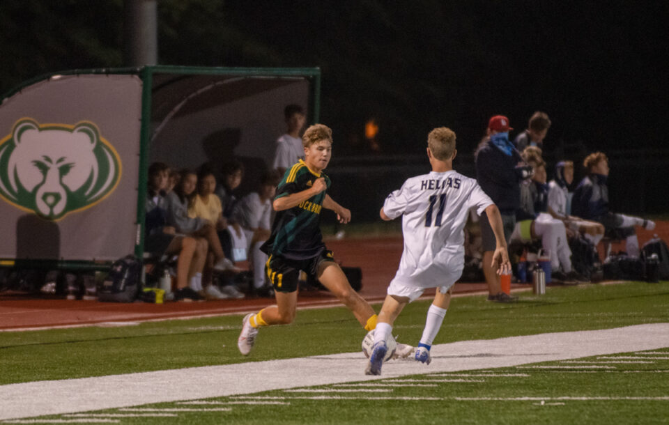 Sophomore Drew Schlimme takes on a Helias defender at the boys' soccer senior night game Wednesday, September 9. Photo by Ana Manzano.