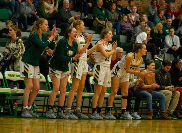 The varsity cheers on their team at the girls' basketball game Thursday, Jan. 30. Photo by Ana Manzano.