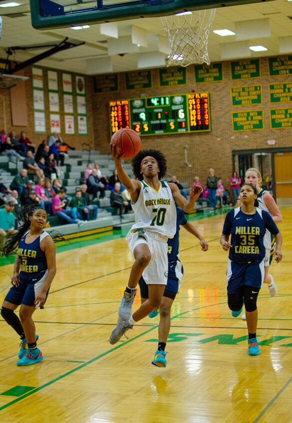 Senior Sanaa' St Andre makes a lay-up against Miller Career Academy at the varsity basketball game Wednesday, Feb. 19. Photo by Ana Manzano.