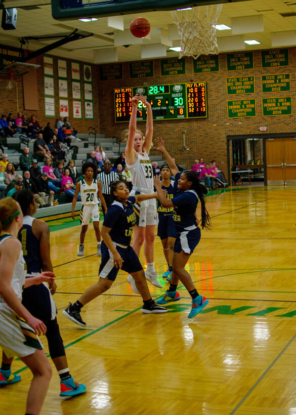 Sophomore guard Kyrah Brodie makes a shot against Miller career Academy Wednesday, Feb. 19. The first half of the girls' basketball game was tight, and neither team was able to settle a lead above six points. Photo by Ana Manzano.
