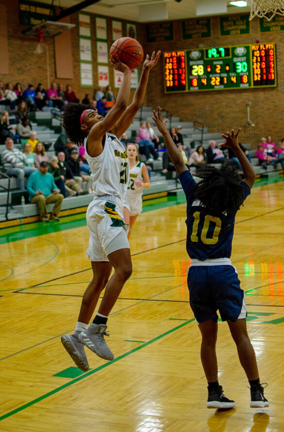 Senior Sanaa' St Andre takes a shot against Miller Career Academy at the varsity basketball game Wednesday, Feb. 19. Photo by Ana Manzano.