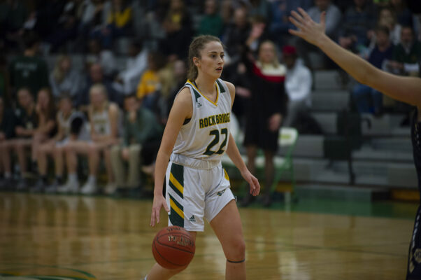 Junior guard Kate Linnemeyer takes the ball down the court. Since the injury of starting sophomore guard Averi Kroenke, Linnemeyer has stepped in.  Photo by Camryn DeVore.