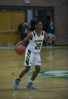 Senior guard Sanaa' St. Andre dribbles the ball across the half court line. St. Andre has been a critical offensive piece for the  Bruins.  Photo by Camryn DeVore.