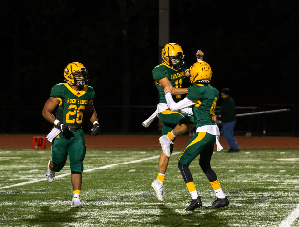 Junior quarterback Nathan Dent and junior Gavin Samuel celebrate after scoring a touchdown in the third quarter Friday, Oct.2. Photo by Ana Manzano.