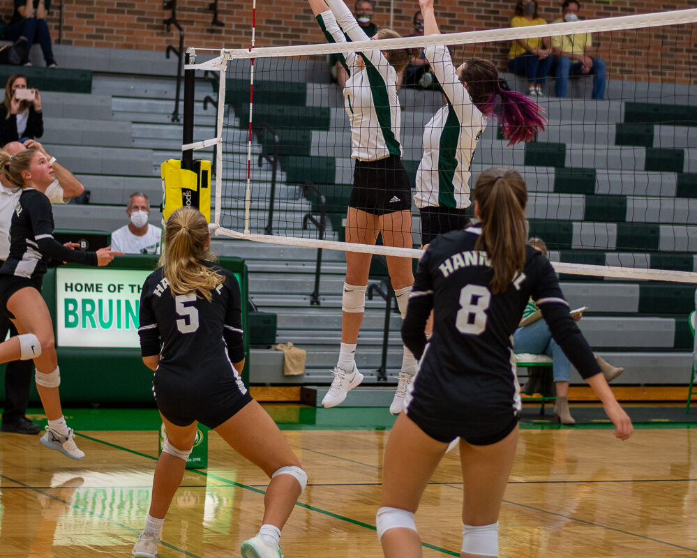 Sophomore setter Ella Swindle and junior middle hitter Ketti Horton jump up for a block at the varsity volleyball game Thursday, Oct. 8. Photo by Ana Manzano.