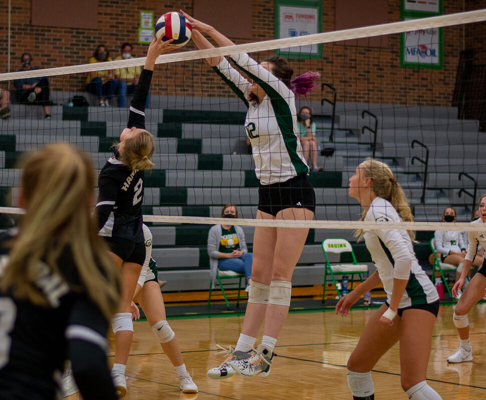Sophomore middle hitter blocks a tip atthe varsity volleyball game Thursday, Oct. 8. The way Horton is flicking her wrists downward instead of having them straight up allows her not not only block the ball, but also go into the offensive. Photo by Ana Manzano.