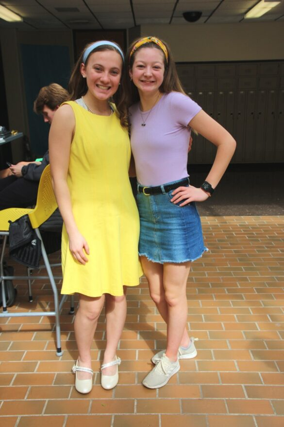 Sophomores Mallory Gard and Gillian Barrett sit in the sunshine of the atrium.  Dressed for spirit week, Gard and Barrett are used to dressing up for student council and cross country.