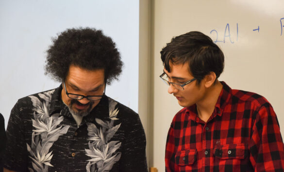 Adviser of GSA club Gregory Kirchhofer and member Harold Johnson IV plan out Tuesday, Dec 10's meeting. In the period between school ends and the meeting starts, club members take the time to set the trajectory of the meeting. Photo by Ana Manzano.