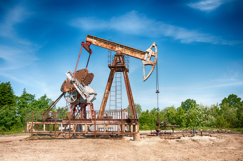 An oil pump is a more primitive example of a means to extract oil from the earth.