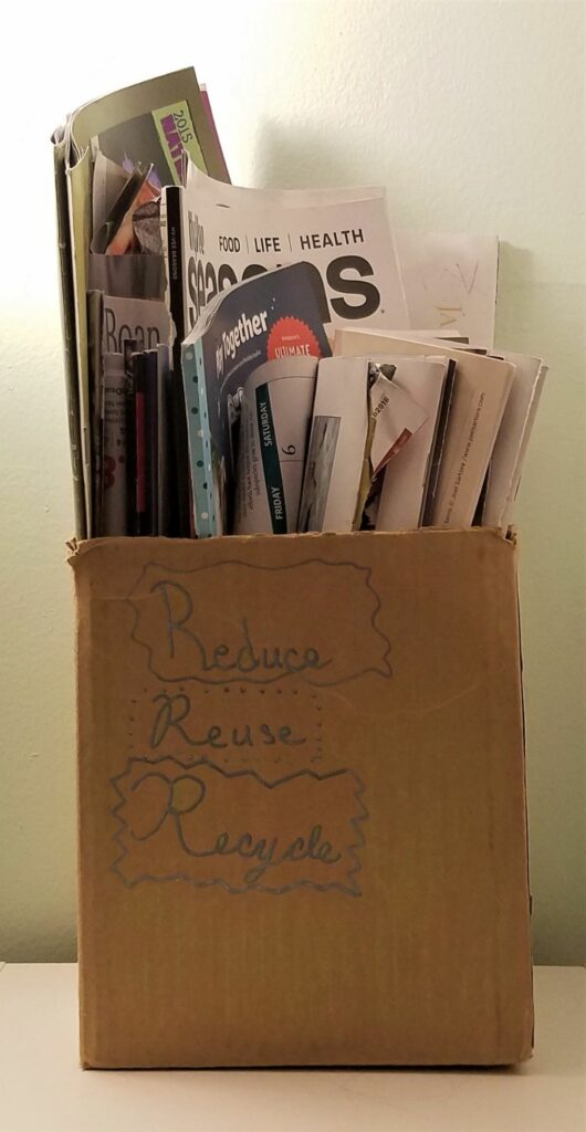 Magazines and used texts in box await craft projects.