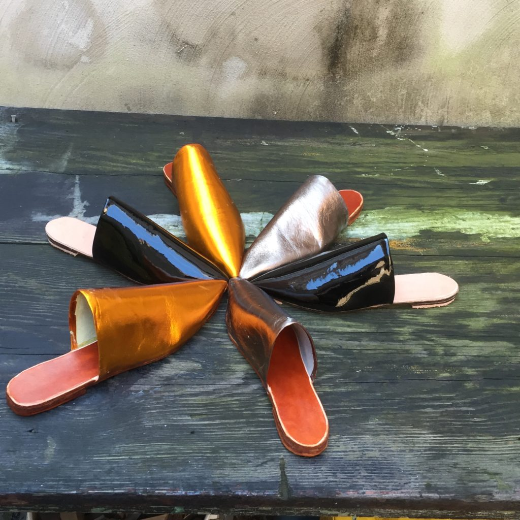 Metallic orange, black patent and Lead roll out of the studio
