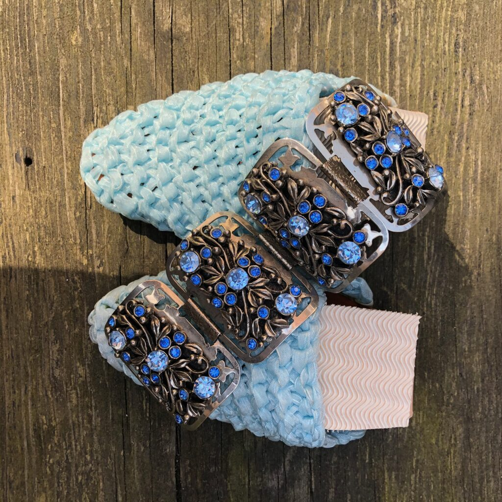 blue folded shoe with bracelet