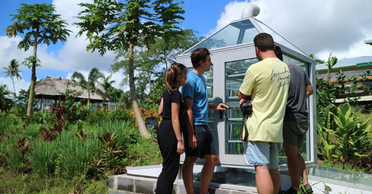 Students inspect fruit dyer in Samoa