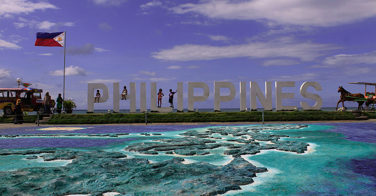 Letters spell our Philippines next to Filipino flag