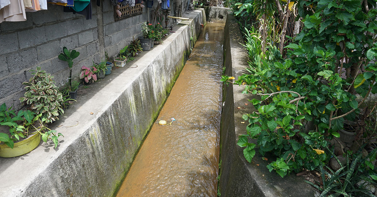 Concrete lined drain with flowing water