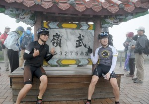 Bikers pose at the 3275-meter high peak of Mt. Wuling, the finish of the arduous KOM Race © 2015 Karen Rubin/news-photos-features.com
