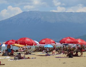 Beachgoers at Lake Ohrid © 2016 Karen Rubin/goingplacesfarandnear.com