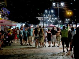 Strolling the promenade at night in the resort town of Saranda on Albania's Riviera © 2016 Karen Rubin/goingplacesfarandnear.com