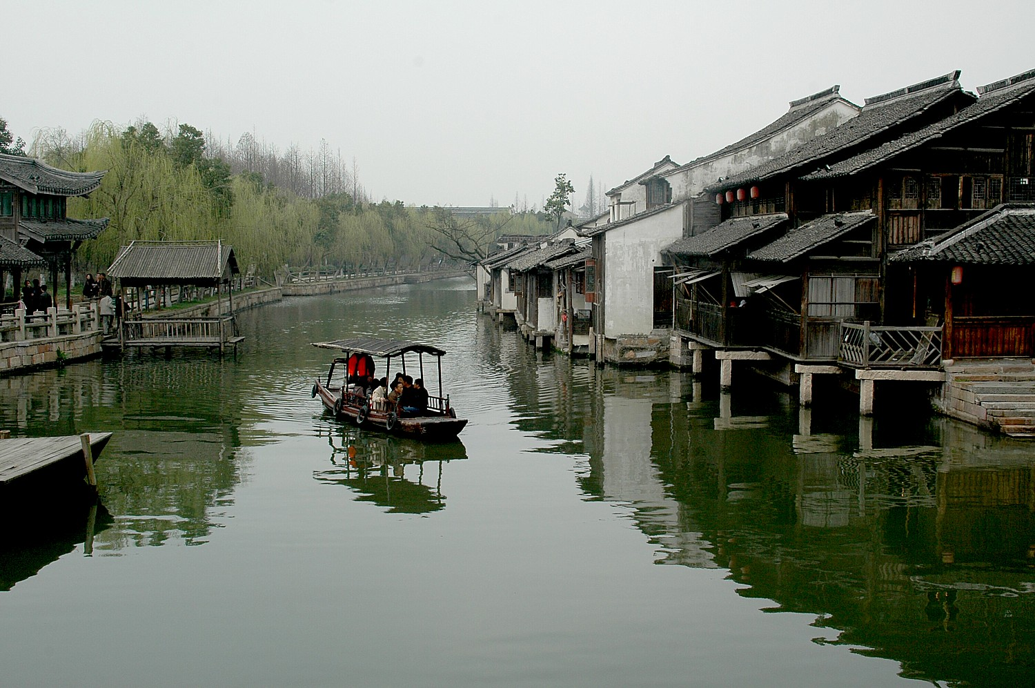 Wuzhen, one of the ancient river towns, has been preserved in Zhejiang Province as a living history museum © 2016 Karen Rubin/goingplacesfarandnear.com.