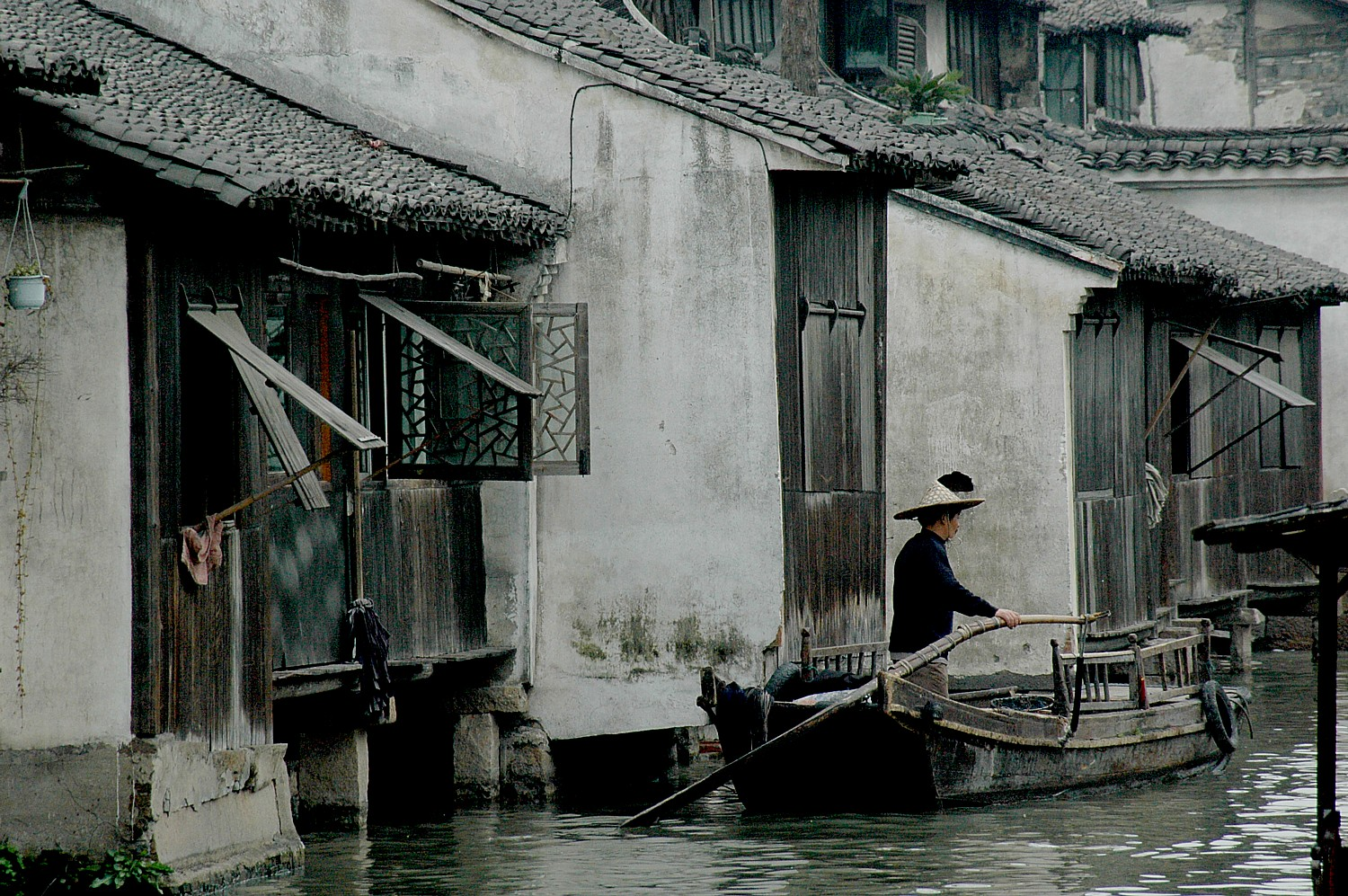 A boatsman at Wuzhen, one of the ancient river towns, has been preserved in Zhejiang Province as a living history museum © 2016 Karen Rubin/goingplacesfarandnear.com