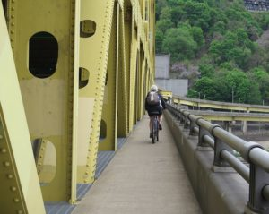 Biking across one of Pittsburgh's 445 bridges (more than any city in the world) © 2016 Karen Rubin/goingplacesfarandnear.com