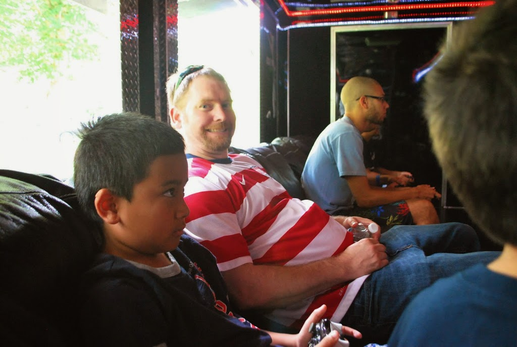 kids playing video games inside a Game Truck at a Minecraft-Themed Game Truck Party