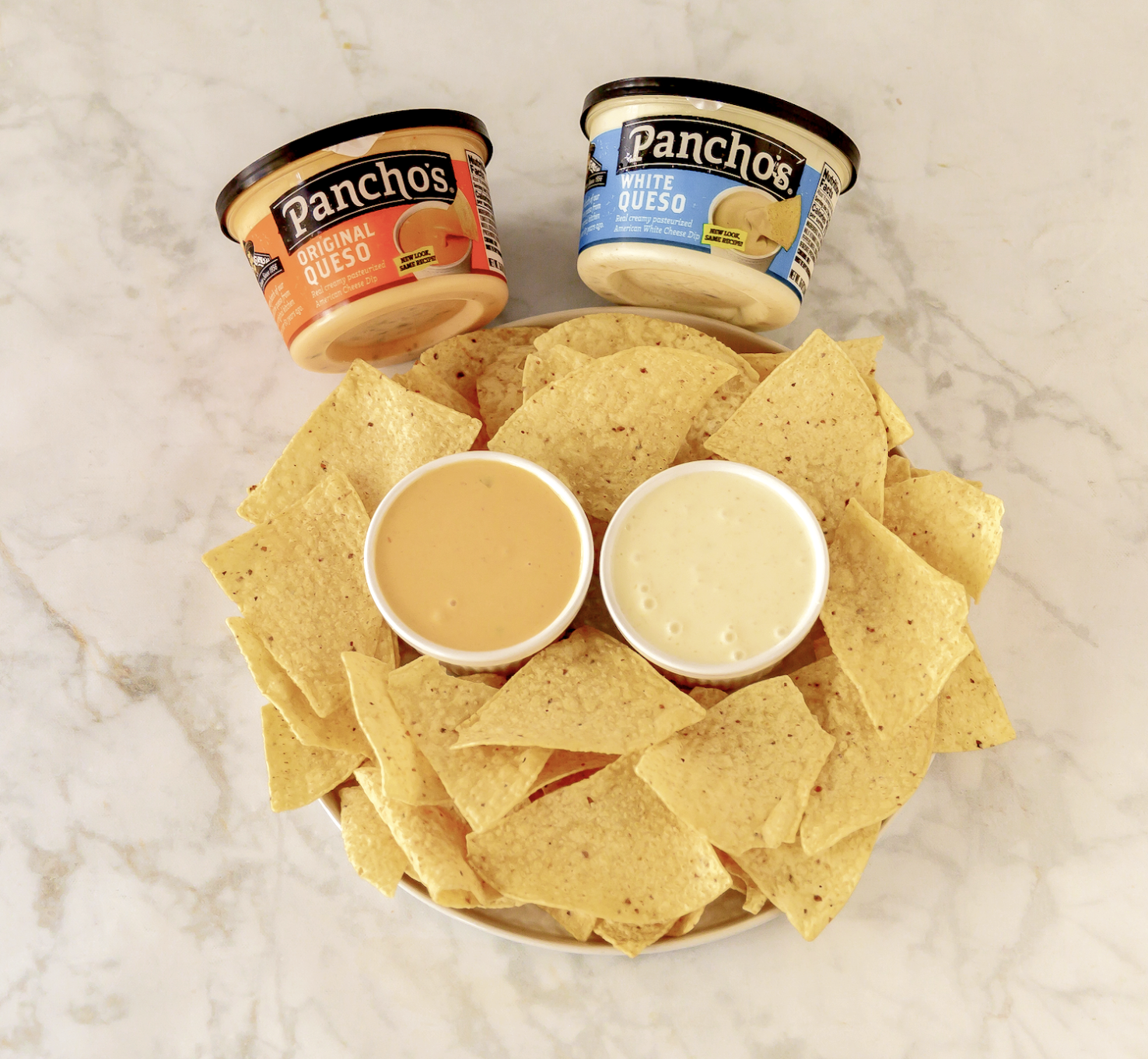 Pancho's Queso Dip in Original Queso and White Queso flavors with corn tortillas