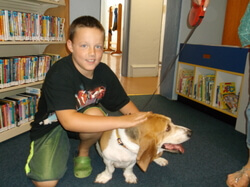 Doggie Day 2014 Young boy with beagle at library