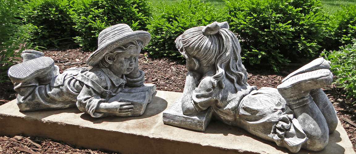 Drake Public Library - statue of two little children reading books