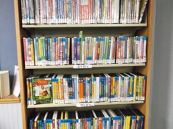 DVD's on the shelf in the Children's Section of the library