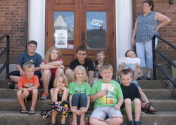 Kids on steps outside of Appanoose County Historical Museum