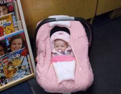 Baby in car seat.
