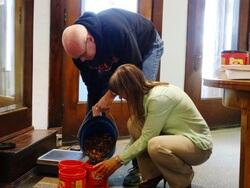 People weighing pennies
